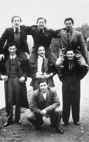 A group of Jewish DPs pose on shoulders in the Landberg displaced persons camp. (Courtesy USHMM/Eric Saul)
