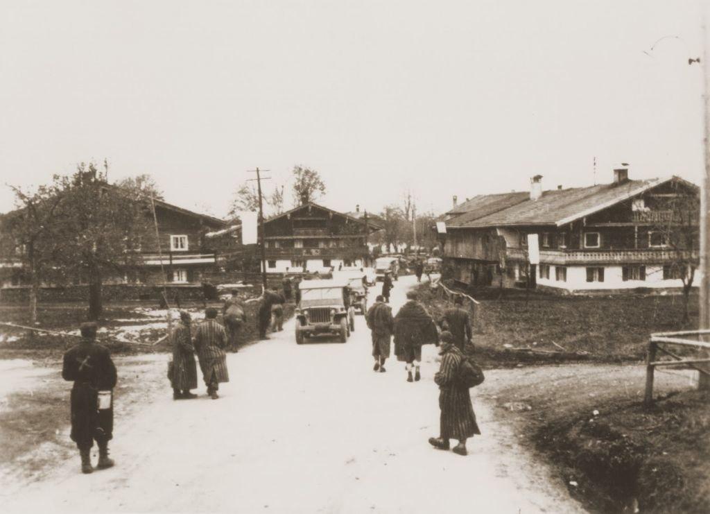 Survivors originally from Kovno liberated by Japanese-American troops with the 522nd Field Artillery Battalion line the road into the town of Waakirchen where US forces set up a field hospital to care for them. (Courtesy USHMM/Eric Saul)