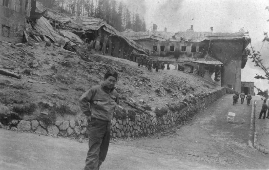 A Japanese-American soldier poses outside the destroyed Berghof, Hitler's mountain retreat in the Bavarian Alps. (Courtesy USHMM/Eric Saul)