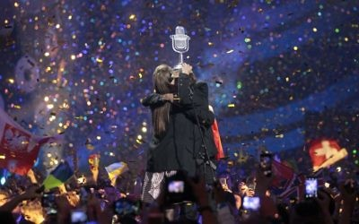 """Salvador Sobral from Portugal, right, embraces his sister Luisa after performing the song """"Amar pelos dois"""" following his win in the Final of the Eurovision Song Contest, in Kiev, Ukraine, Saturday, May 13, 2017. (AP/Efrem Lukatsky)"""