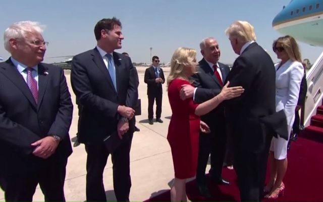 Prime Minister Benjamin Netanyahu and his wife, Sara, greet US President Donald Trump upon his arrival at Ben Gurion Airport on Monday, May 22, 2017 (screen capture: GPO)