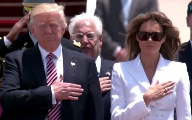 US President Donald Trump and his wife, Melania, stand for the US anthem at the Ben Gurion Airport on Monday, May 22, 2017 (screen capture: GPO)