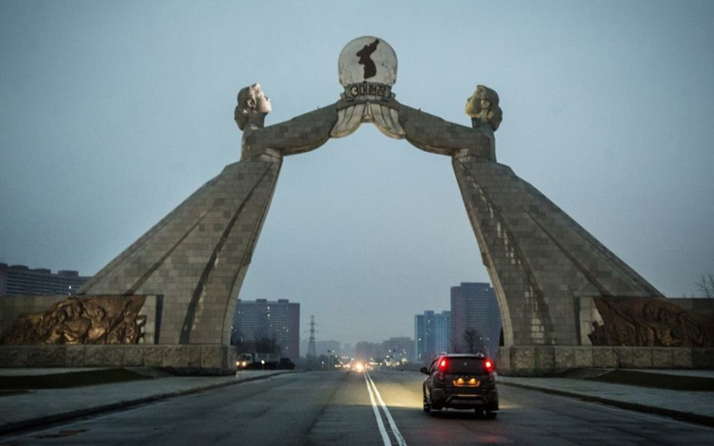 The Arch of Reunification straddles the Reunification Highway, which connects Pyongyang with the DMZ. The two women symbolize North and South Korea. (Moshe Shai)