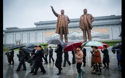 Visitors in front of the Mansu Hill Grand Monument in Pyongyang, North Korea. (Moshe Shai)