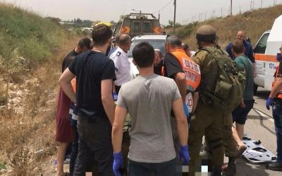 Rescuers at the site where a 19-year-old woman was found dead, near Zufim in the northern West Bank, May 1, 2017. (Magen David Adom)