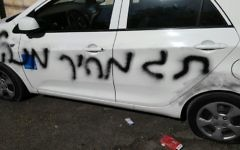 A car daubed with 'administrative price tag' in East Jerusalem, May 9, 2017. (Amar Arouri/B'Tselem)