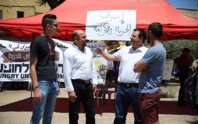 Joint (Arab) List chair Ayman Odeh (2nd right) at a solidarity tent for hunger-striking Palestinian security prisoners, in the northern Arab-Israeli city of Nazareth, May 11, 2017. (Courtesy)