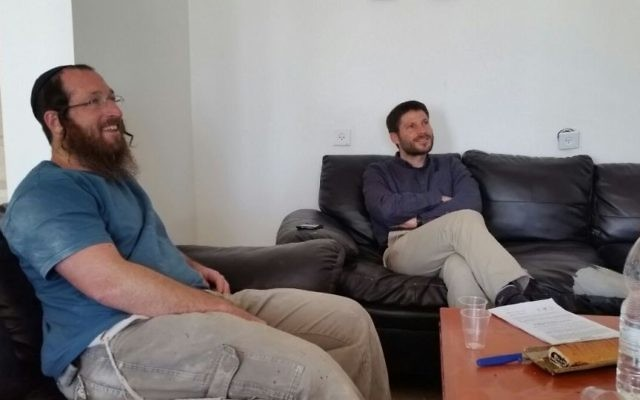 Elkana Pikar (L) sits with Jewish Home MK Bezalel Smotrich in the formers home in the Yitzhar settlement on May 16, 2017. (Courtesy: We are all Elkana Pikar HQ)