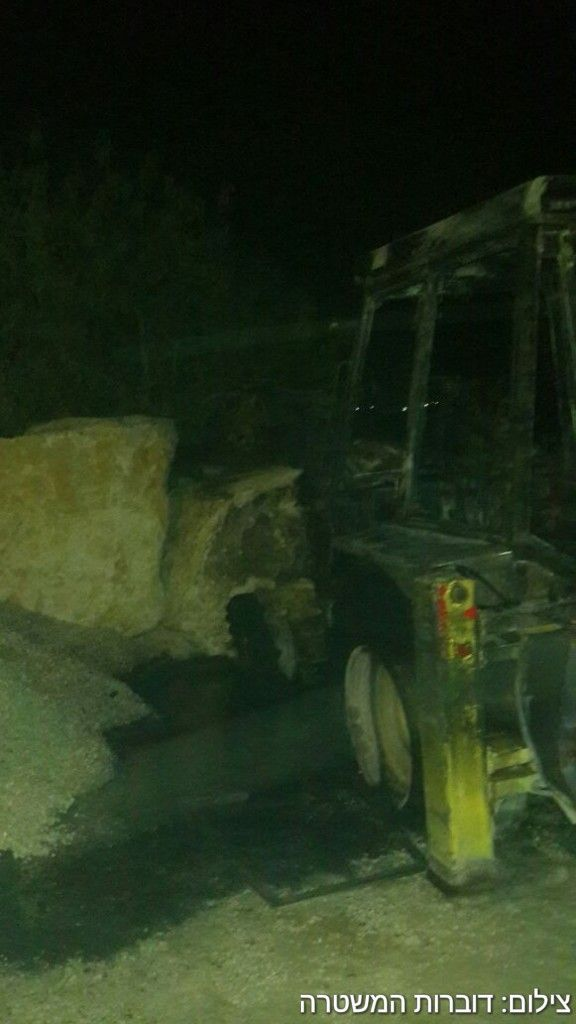 A burned out tractor in the Palestinian village of Burin after a suspected arson attack on May 19, 2017. (Police spokesperson)