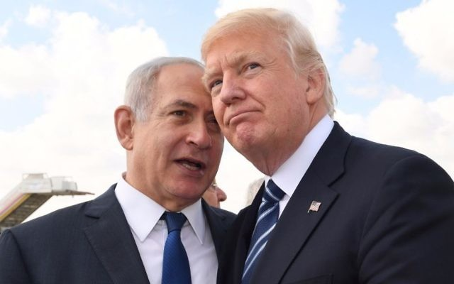 Prime Minister Benjamin Netanyahu, left, and US President Donald Trump, right, speak at Ben Gurion International Airport prior to the latter's departure from Israel on May 23, 2017. (Koby Gideon/GPO)
