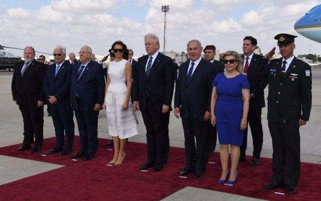 US Ambassador to Israel David Friedman (2nd-L), President Reuven Rivlin (3rd-L), First Lady Melania Trump (C-L), US President Donald Trump (C-R), Prime Minister Benjamin Netanyahu (3rd-R) and Sara Netanyahu (2nd-R) seen at Ben Gurion International Airport during a ceremony marking American president's departure from Israel on May 23, 2017. (Koby Gideon/GPO)
