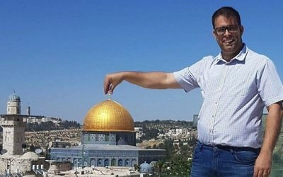 Likud MK Oren Hazan in a pose that makes him appear to be holding the Golden Dome atop the Temple Mount. (Oren Hazan)