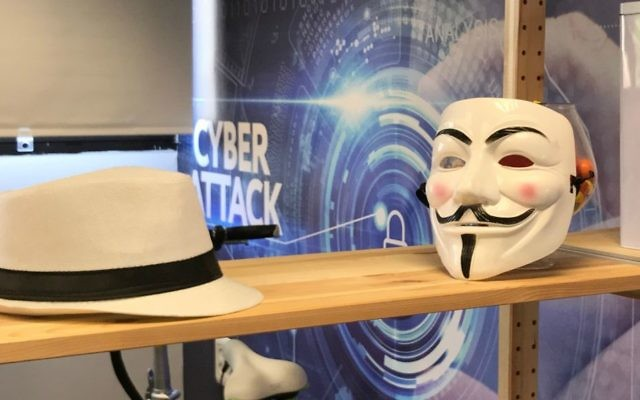 At White-Hat's offices in Tel Aviv, a white hat faces a Gur Fawkes mask of the type favored by the hacker group called Anonymous (Shoshanna Solomon/Times of Israel)