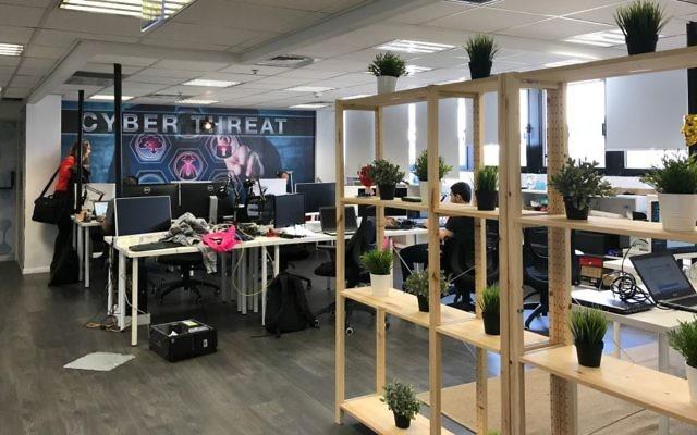 Desks and hackers at White-Hat offices in Tel Aviv (Shoshanna Solomon/TimesofIsrael)