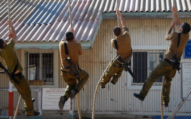 Illustrative. Soldiers climb a rope on the Israeli Navy's Haifa Base on June 19, 2013. (Israel Defense Forces)