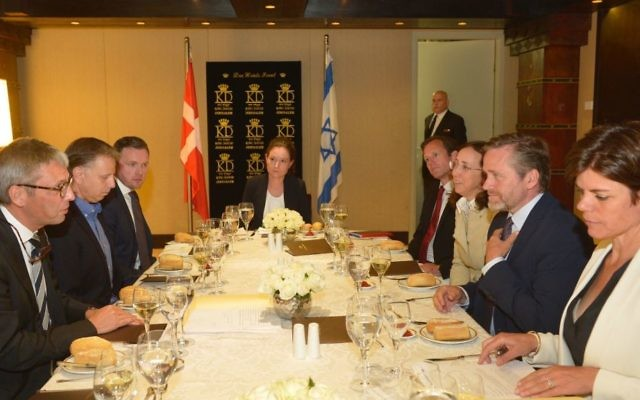 Anders Samuelsen, Denmark's Minister for Foreign Affairs, at the right side of the table and second from right, meets with representatives of Israeli high tech industry in Jerusalem. He is faced by Danish Ambassador to Israel, Jesper Vahr, and flanked to his left by incoming Ambassador to Israel Charlotte Slente (Courtsy: Yossi Zwecker)