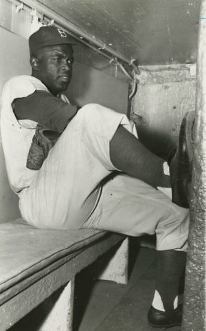 Jackie Robinson in dugout, circa 1950. (Brooklyn Historical Society)