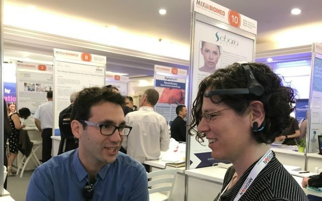 Participants at MIXiii BIOMED conference in Tel Aviv tests out BrainMARC's brain monitoring technology (Courtesy: Shoshanna Solomon)