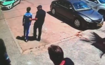 A 14-year-old boy who has apparently spent most of his life at his Hadera home is escorted out by police on May 11, 2017. (Channel 2 News)