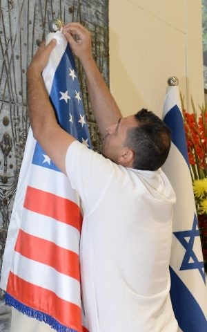 An American flag is hung at the President's Residence in Jerusalem, prior to a visit by US President Donald Trump, May 18, 2017. (Mark Neiman / GPO)