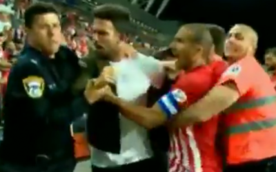 Players from Hapoel Tel Aviv and police scuffle at the end of a soccer match on May 6, 2017. (Screen capture: Twitter)