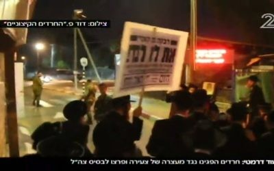 Ultra-Orthodox demonstrators protesting for the release of jailed draft dodgers break into Tzrifin army base, May 10, 2017. (Screen capture: Channel 2)