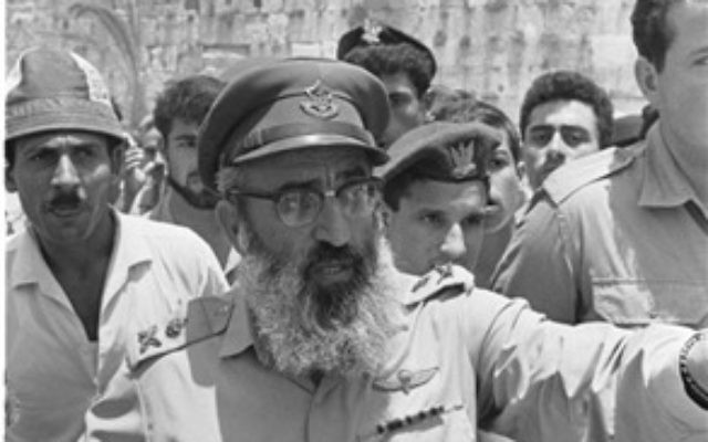 Israel Defense Forces Chief Rabbi Shlomo Goren gestures against the backdrop of the Western Wall, June 22, 1967. (From the collection of Dan Hadani, National Library of Israel).