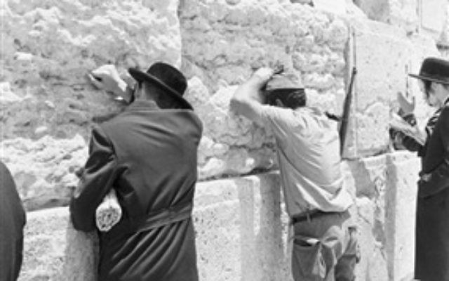 Praying at the Western Wall, June 22, 1967. (From the collection of Dan Hadani, National Library of Israel).
