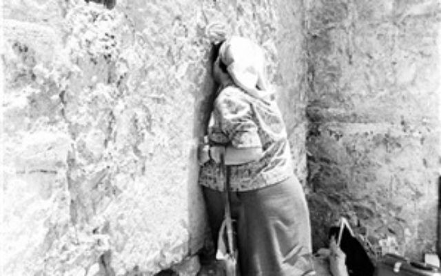 A woman prays at the Western Wall, June 22, 1967.  (From the collection of Dan Hadani, National Library of Israel).