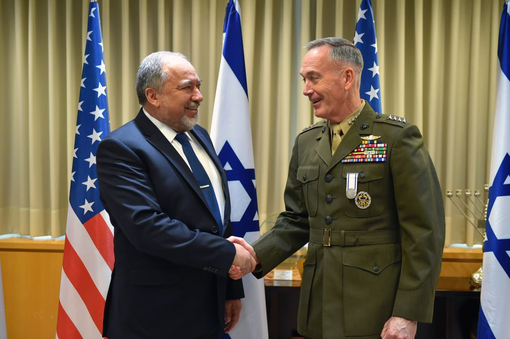 Chairman of the US Joint Chiefs of Staff Joseph Dunford, right, shakes hands with Defense Minister Avigdor Liberman in the ministry's Tel Aviv headquarters on May 9, 2017. (Ariel Hermoni/Defense Ministry)