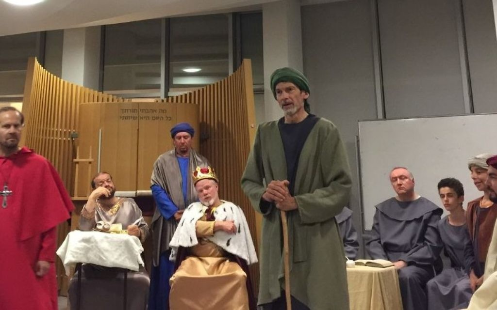 At a dress rehearsal of 'Divine Right,' Rabbi David Golinkin (right, in green robes), holds forth as Nahmanides (Jessica Steinberg/Times of Israel)