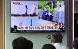 People watch a TV news program showing images of North Korean leader Kim Jong Un and the missile launch, published in the North Korea's Rodong Sinmun newspaper, at Seoul Railway station in Seoul, South Korea, Monday, May 22, 2017. (AP Photo/Lee Jin-man)