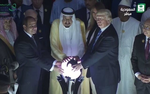 A screenshot of US President Donald Trump, Saudi King Salman and Egyptian President Abdel-Fatah al-Sissi touching a glowing globe to launch the opening of an anti-extremisn center in Riyadh on May 21, 2017. (Screenshot)