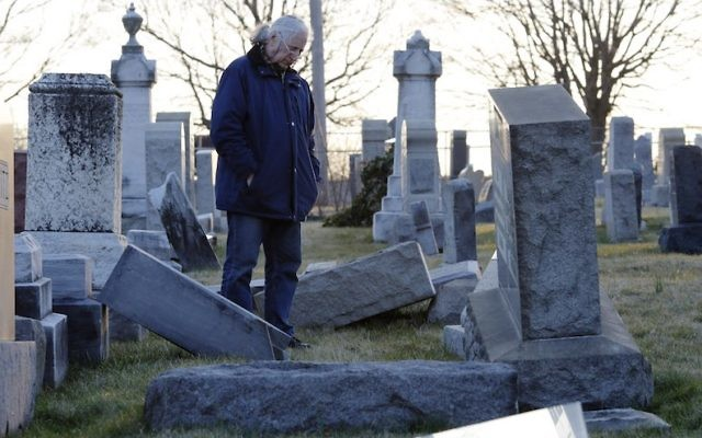 A man looking at fallen tombstones at the Jewish Mount Carmel Cemetery in Philadelphia, February 26, 2017. (Dominick Reuter/AFP/Getty Images)