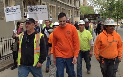 Marchers protesting labor arrangements at the Jewish Theological Seminary's construction site in New York City say the building contractor violates workers' rights, May 1, 2017. (Ben Sales/JTA)