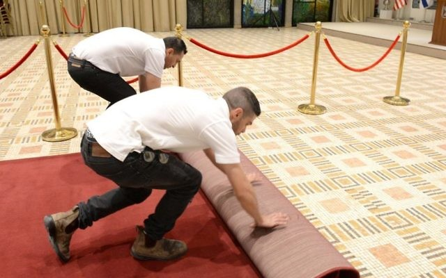 Workers roll out the red carpet at the President's residence in Jerusalem, prior to US President Donald Trump's upcoming visit, May 18, 2017 (Mark Neiman / GPO)