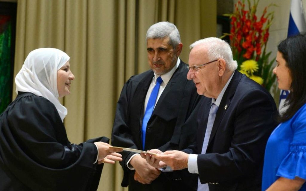 Israel's first woman sharia judge, Hana Khatib, left, is sworn in by President Reuven Rivlin, second right, at the President's Residence in Jerusalem on May 15, 2017. Justice Minister Ayelet Shaked is at right. (President's Residence Twitter account screen capture)