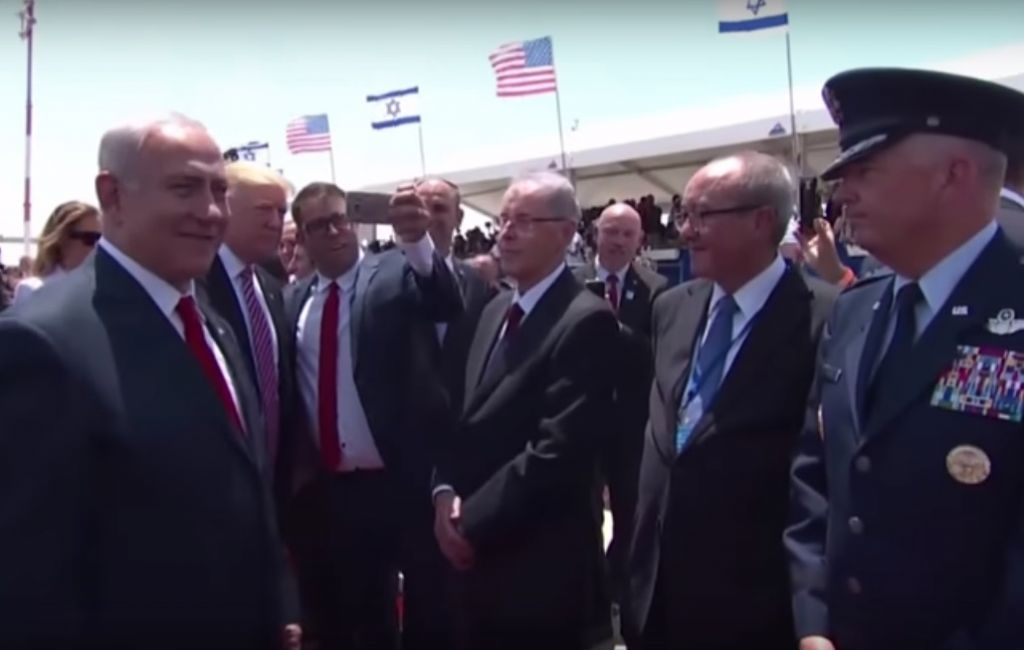 Likud lawmaker Oren Hazan (third from left) attempts a selfie photograph with US President Donald Trump (second from left) on the tarmac at Ben Gurion Airport, May 22, 2017. (YouTube screenshot)