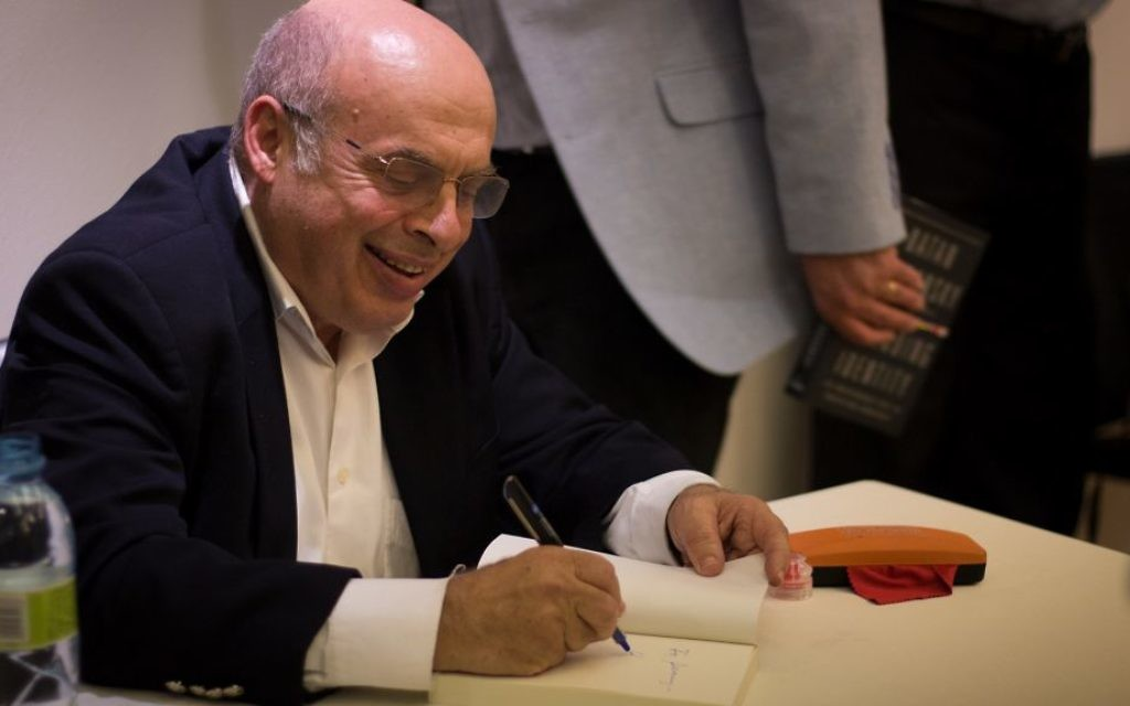 Natan Sharansky signs books at a Times of Israel event in Jerusalem, May 7, 2017. (Luke Tress/Times of Israel)