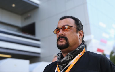 Actor Steven Seagal attends qualifying ahead of the Russian Formula One Grand Prix at Sochi Autodrom on October 11, 2014 in Sochi, Russia (Clive Mason/Getty Images via JTA)