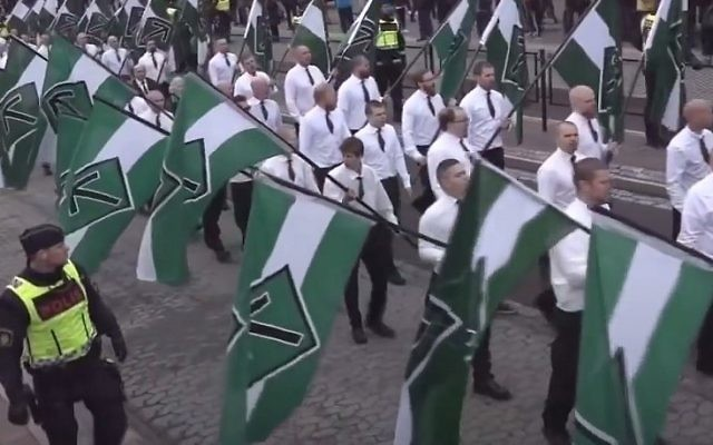 Members of the Nordic Resistance Movement (NRM) march on May Day, 2016, in Borlänge, Sweden (YouTube screenshot)