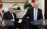 US President Donald Trump (right) giving a joint statement with Palestinian Authority President Mahmoud Abbas in the Roosevelt Room of the White House, May 3, 2017. (Olivier Douliery-Pool/Getty Images via JTA)