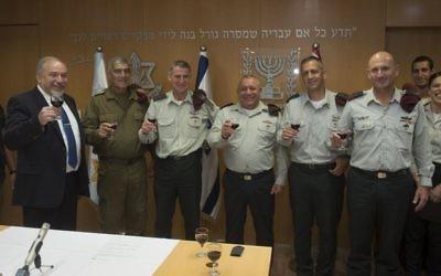 From left, Defense Minister Avigdor Liberman, Maj. Gen. (res.) Tal Russo, Maj. Gen. Yair Golan, IDF Chief of Staff Gadi Eisenkot, Maj. Gen. Aviv Kochavi and Maj. Gen. Muni Katz raise a toast at a ceremony in the army's Tel Aviv headquarters on May 11, 2017. (IDF Spokesperson's Unit)