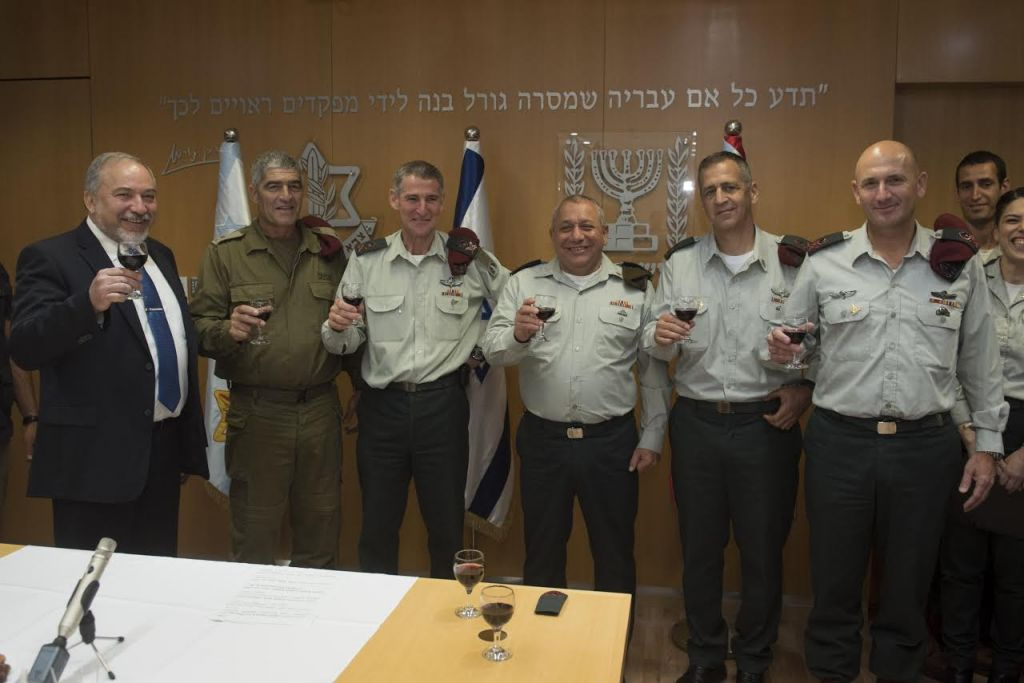 From left, Defense Minister Avigdor Liberman, Maj. Gen. (res.) Tal Russo, Maj. Gen. Yair Golan, IDF Chief of Staff Gadi Eisenkot, Maj. Gen. Aviv Kochavi and Maj. Gen. Muni Katz raise a toast at a ceremony in the army's Tel Aviv headquarters on May 11, 2017. (IDF Spokesperson's Unit)