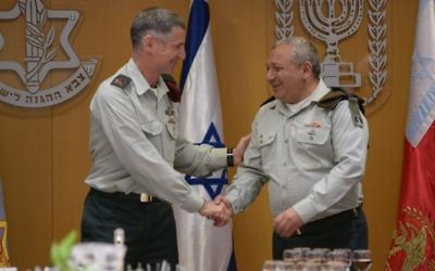 Outgoing deputy chief of staff Maj. Gen. Yair Golan, left, shakes hands with IDF Chief of Staff Gadi Eisenkot at a ceremony in the army's Tel Aviv headquarters on May 11, 2017. (Israel Defense Forces)