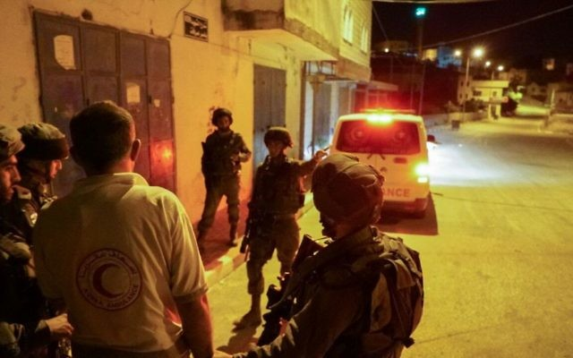 IDF arrests an ambulance driver, impounds his vehicle in the northern West Bank on May 19, 2017. The ambulance blocked the escape of an Israeli man who came under attack by a mob during a protest in the village of Hawara, outside Nablus. (IDF Spokesperson's Unit)