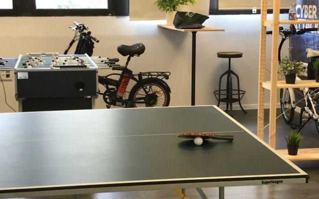 Ping-pong table, bikes in White-Hat's Tel Aviv offices (Shoshanna Solomon/TimesofIsrael)
