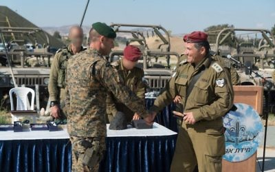 The commander of the IDF's Commando Brigade, Col. David Zini, shakes hands with an officer of the Cypriot military during an exercise in Cyprus in June 2017. (IDF Spokesperson's Unit)
