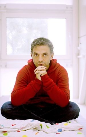 Etgar Keret inside the world's narrowest house in Warsaw, Poland, a temporary home for traveling writers, named for Keret (Courtesy Eva Sztibalko)