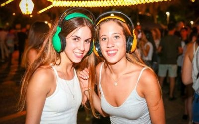 Getting the groove on with the Rabin Square earphones party for White Night, Thursday night, June 29 (Courtesy Guy Yechiely)